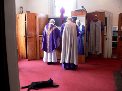 supervising preparations for Mass